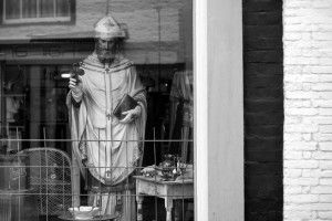 A statue of St Patrick in an antique shop window (c) david perry/flickr (CC BY-NC-SA 2.0)