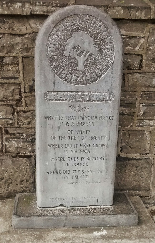 "A stone bearing the image of a tree and the ""United Irishmen Catechism"""