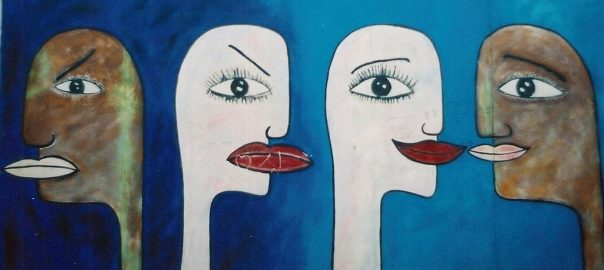"""""""Tolerance"""" by Mary Mackay, East Side Gallery. Berlin. Mural depicting two faces angrily turned away from each other and the same two faces facing each other and smiling"""